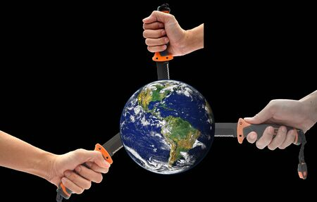 Concept: Hand holding a knife to stab the world. Violence in the world. isolated on black background.