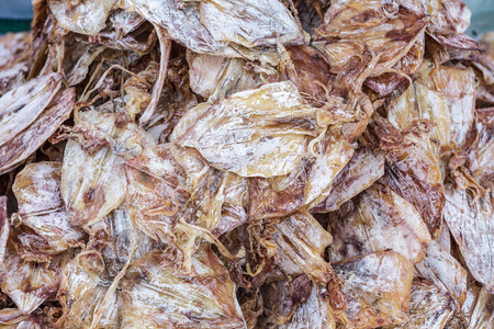 Dried squid sell on market. Local street food, Thailand. photo