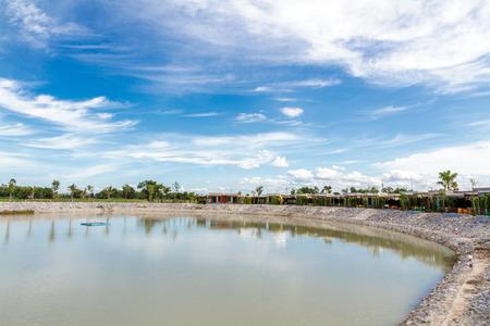 thani: Resort beside lake background blue sky and white cloud. Uthai thani, Thailand.
