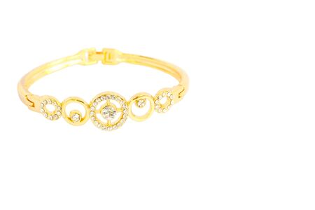 fake diamond: Gold bracelets adorned with diamonds. Fake jewelry. Clipping path in picture.