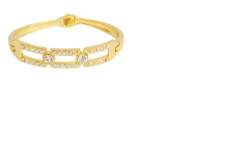 adorned: Gold bracelets adorned with diamonds. Fake jewelry. Clipping path in picture.