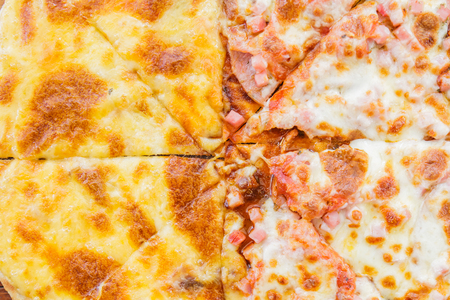 Pizza Meat lover with sausage, salami, ham, bacon, pepperoni and cheese in restaurant.top view. Stock Photo