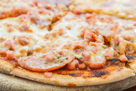 Pizza Meat lover with sausage, salami, ham, bacon, pepperoni and cheese in restaurant. Stock Photo