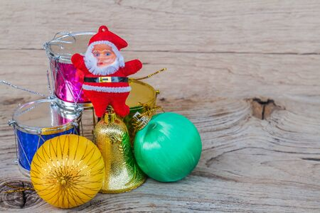tassel: Xmas day: Merry Christmas decoration with ball, bell, drum, bow, tassel and santa claus doll on wood background.