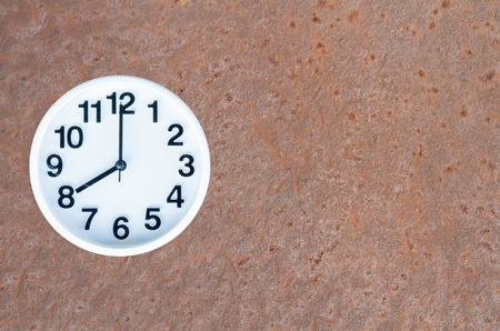 pm: Clock show 8 am or pm on steel rusty background with copy space.