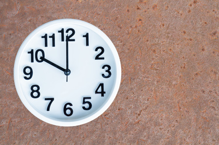 pm: Clock show 10 am or pm on steel rusty background with copy space.