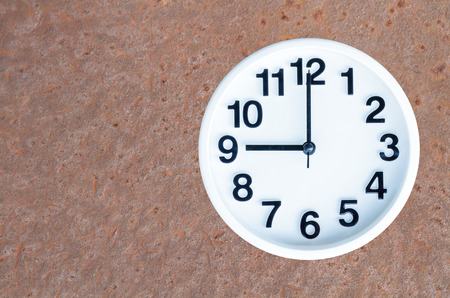 pm: Clock show 9 am or pm on steel rusty background with copy space.