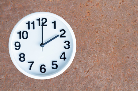 pm: Clock show 2 am or pm on steel rusty background with copy space. Stock Photo