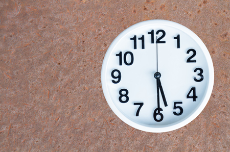 pm: Clock show 5 am or pm and 30 minute on steel rusty background with copy space. clipping path in picture.