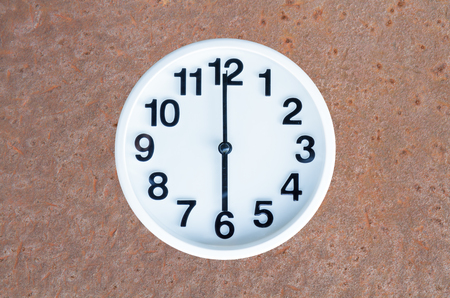 pm: Clock show 6 am or pm on steel rusty background with copy space.