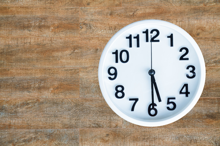 pm: Clock show 5 am or pm and 30 minute on wood background with copy space.