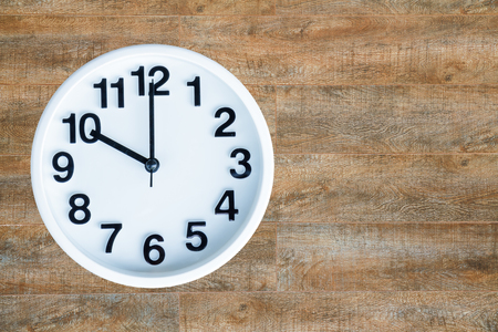 pm: Clock show 10 am or pm on wood background with copy space.