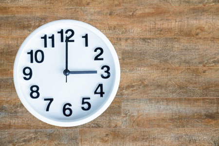 pm: Clock show 3 am or pm on wood background with copy space. Stock Photo