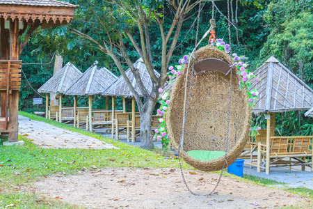 swing seat: Swing seat egg shaped in the garden on a casual day. Stock Photo
