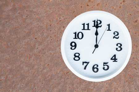 pm: Clock show 12 am or pm on steel rusty background with copy space. clipping path in picture.