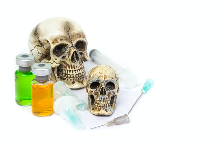 Skull and drug syringe with copy space.