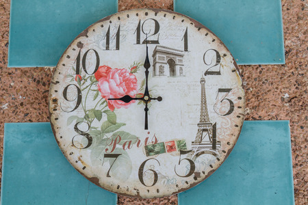 pm: Vintage clock show 9 am or pm on wall. Stock Photo