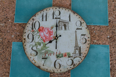 pm: Vintage clock show 8 am or pm on wall. Stock Photo