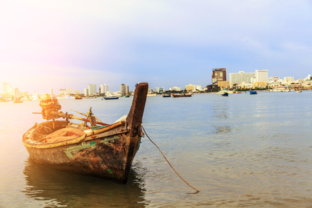 Selling an old rowboat tied to the sea, Pattaya, Chonburi, Thailand.