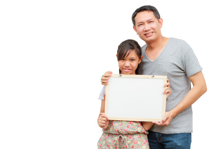 Asian thailand father and daughter smile holding blank board, isolated on white background with copy space. Board with blank can add your text or others.