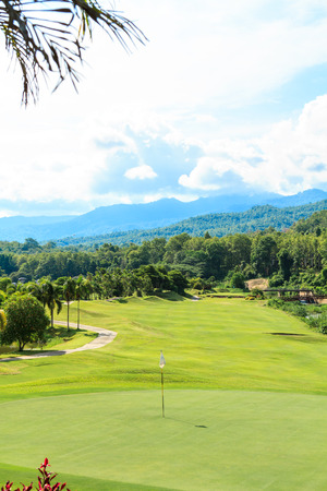 golfing: Beautiful green golf course landscape, Golfing resort at Lamphun Province, Thailand.
