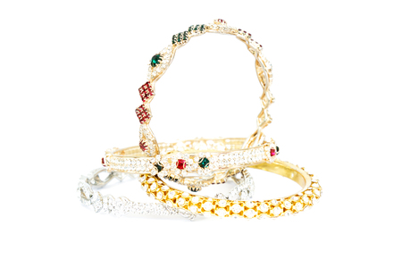 Gold bracelets with gem and diamonds isolate on white background.
