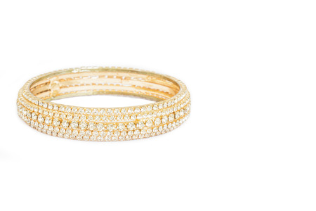 porpoise: Gold bracelets with gem and diamonds isolate on white background.