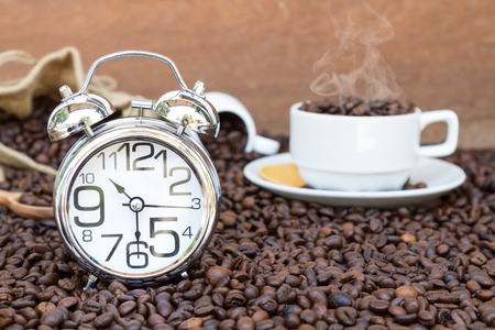 pm: Clock show time 10 am or pm and  30 minute background coffee with mug on coffee bean with copy space.