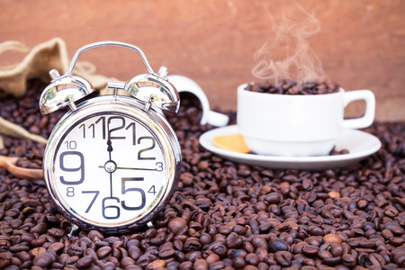 pm: Clock show time 12 am or pm background coffee with mug on coffee bean with copy space.