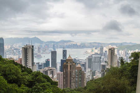 HONG KONG, CHINA – APRIL 24: Viewpoint on The Peak before rain sky have rain cloud on April 24, 2016 in The Peak, Hong Kong, China.