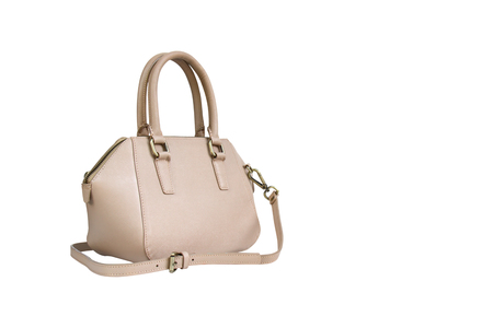 woman handle success: Handbag leather cream color isolated on white background with copy space. clipping path in picture. Stock Photo