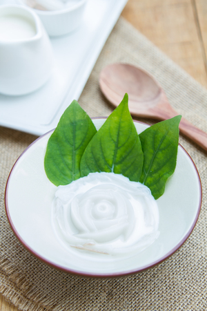 gelatina: Coconut jelly coconut milk in cup on wood background local dessert thailand.