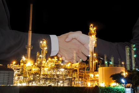 Business people shake hand success a contract with the crisis, oil price fluctuate.