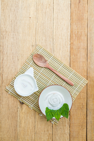 Coconut jelly coconut milk in cup on wood background local dessert thailand. Top view.
