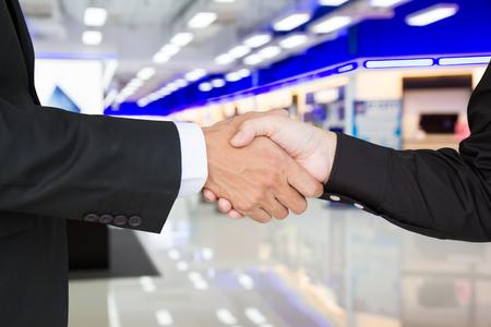 advice: Businesswoman shake hands businessman to success. Selective focus.