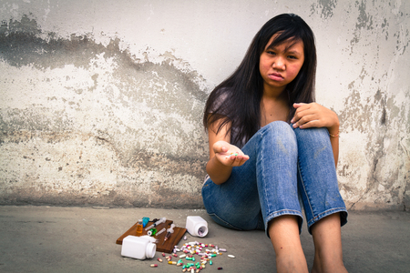 gloom: Concept Asia young girl is sad by drug addiction. Drug addiction in adolescence.