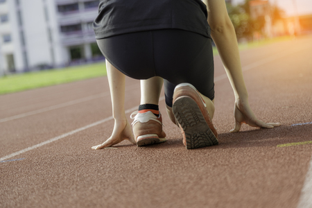 Sport girl preparation start to competition just like success to life or work to next goal. Stock Photo