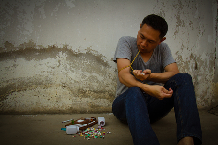 Concept Asia man is sad and pain by drug addiction problem.