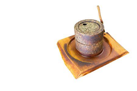 Grind coffee bean it make stone ancient on wooden table isolated on white background with copy space. Clipping Path in Picture.