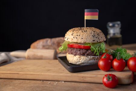 Hamburger homemade on wood table with copy space. Stock Photo