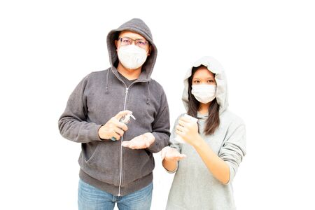 Dad and daughter wearing a health mask and holding a hand wash gel to prevent virus or flu or covid19 or coronavirus and white background with copy space. Clipping path in the picture.