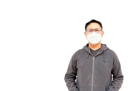 Asian middle age man Asia ethnic wearing health mask to prevent virus or flu or covid19 or coronavirus and white background copy space. Clipping path in the picture.