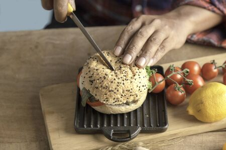 The butler chef use knife cutting hamburger homemade in kitchen. Stock fotó