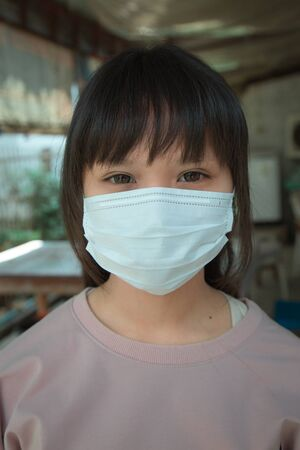 Asian teenage girls Asia ethnic wearing health mask to prevent virus or flu or covid19 or coronavirus.