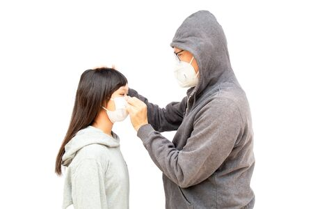Asian dad and daughter Asia ethnic wearing health mask to prevent virus or flu or covid19 or coronavirus and white background with copy space. Clipping path in the picture.