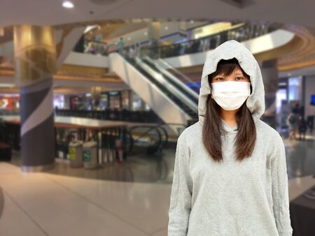 Asian teenage girls Asia ethnic wearing health mask to prevent virus or flu or covid19 or coronavirus in the shopping mall.