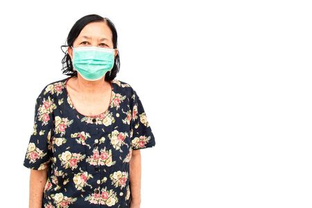 She is Asian elderly woman Asia ethnic wearing health mask to prevent virus or flu or covid19 or coronavirus isolated on white background with copy space and clipping path in picture. Stock fotó - 143674427