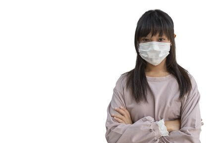 Asian teenage girls Asia ethnic wearing health mask to prevent virus or flu or covid19 or coronavirus and with background with copy space. Clipping path in the picture.