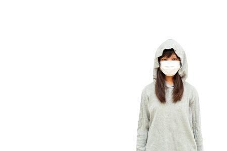 Asian teenage girls Asia ethnic wearing health mask to prevent virus or flu or covid19 or coronavirus and white background with copy space. Clipping path in the picture. Stock fotó