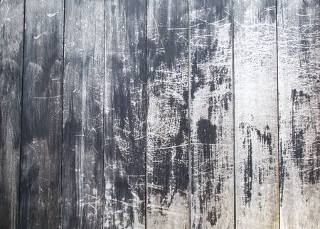 Old black wood grain, the color falls off until seeing white texture background with copy space. Is a horizontal image.